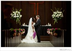 2 large flower arrangements for the front of the church that look similar to this (white and green) but go with the bridesmaids bouquets. + 10 pew arrangements (5 on each side) that will be repurposed as table arrangements at the reception. (this is the chapel where the ceremony will be held)
