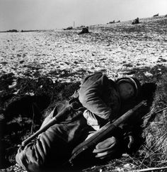 Robert Capa  - Belgium. Near Bastogne. December 23rd-26th, 1944. US soldier in his foxhole during the Battle of the Bulge.