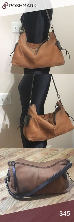 """Alfa i leather hobo Alfani leather camel brown soft leather with coffee brow trim and silver hardware. Slip pockets on either side. Zip top closure. Inside lined in tan water resistant fabric and has 2 zippered pockets and 1 slip pocket 13.5 """"W 8""""T 9"""" strap drop. Alfani Bags Hobos"""