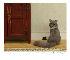 'Good things come to those that wait...' -- a miniature cat sculpture by Kerri Pajutee