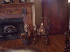 i love this old Antique Rocker and the Primitive Doll just fits it Perfectly  !