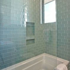 Guest bath tile idea - Gorgeous Shower Tub Combo With Walls and Bath Surround Tiled in Blue Glass subway tile Glass Tile Bathroom, Bathroom Windows, Bathroom Renos, Small Bathroom, Glass Tiles, Bathroom Ideas, Bathroom Mirrors, Mosaic Tiles, Blue Glass Tile