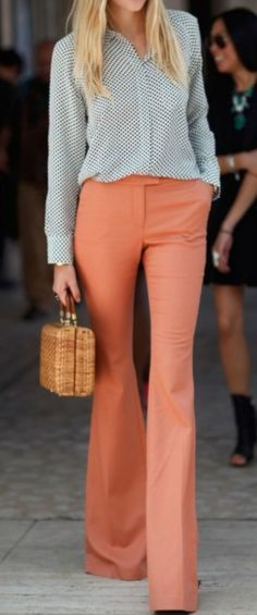 Coral bootcut pants with black and white polka dotted blazer
