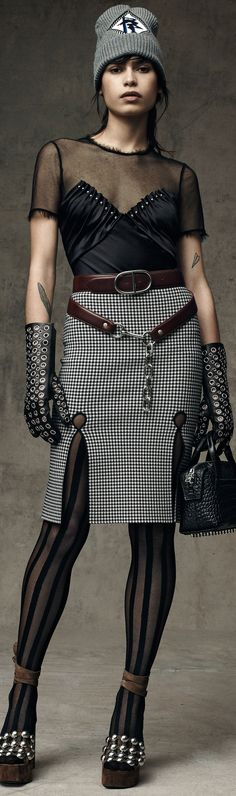 31 May 2016 - Printed fabric skirt, mea=sh satin top, leather embellished gloves and beanie. Alexander Wang   Pre-Fall 2016