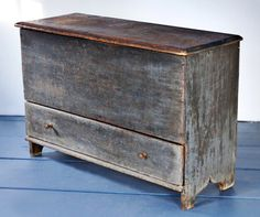 Skinner's - The Personal Collection of Lewis Scranton, Auction 2897M. May 21, 2016. Lot: 144.  Estimate: $1,000-1,500.  Realized: $2,500.   Description:  Painted Pine Blanket Chest over Drawer, Massachusetts, 18th century, molded lift top with cutout ends and applied molding on skirt, old surface, ht. 27, wd. 40, dp. 16 in.   Provenance: Hilary Nolan, 1991.