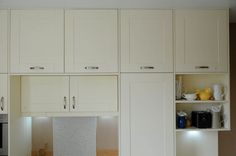 Painted white wood kitchen with recycled glass splashback - Sheffield…
