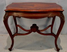 Found on EstateSales.NET: 357 - French Victorian flame mahogany top, 30in. T, 36in. W, 24in. D., signed Miller Cabinet Co.