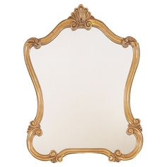 Antiqued metal wall mirror in gold with a scrolling silhoutte. Product: Mirror    Construction Material: Metal and mi...