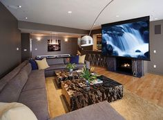 A once dreary basement has been converted into a sleek home entertainment centre complete with a cinema screen, stunning fireplace and cosy corner sofas. Home Theater Rooms, Home Theater Design, Cinema Room, My Living Room, Living Room Decor, Interior Minimalista, Decoration Inspiration, Luxury Estate, Home Entertainment