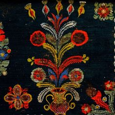 Poland - Decoration on Kraków Region chest typical of Skawina area: plant ornamentation in the form of symmetrical inflorescence in a vase with S