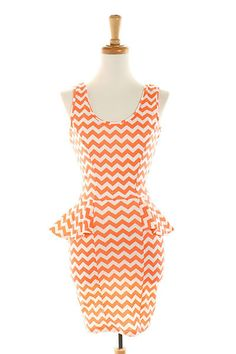 Loving this orange chevron Peplum Dress...paired with some spring pumps ..too cute!