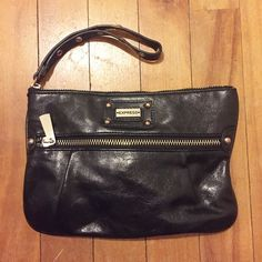 Express wristlet/clutch Black wristlet/clutch from Express. Great size can even fit fast flats in! Price reflective of pre-loved condition but very clean and you'll use it all the time. Express Bags Clutches & Wristlets
