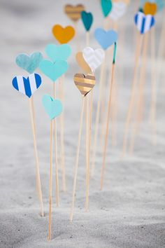 Awesome DIY idea for making heart picks for wedding aisle decor using a @fiskars_hq punch!