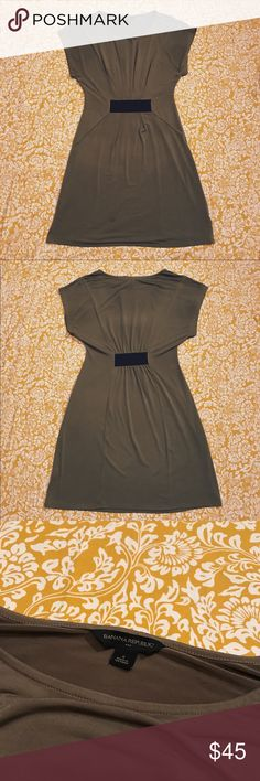 Banana Republic Dress Sleek beige dress with black elastic detailing in the front and back. Great dress for work and for cocktails! Small oil spot on the front, barely noticeable. Make me an offer! Banana Republic Dresses Midi