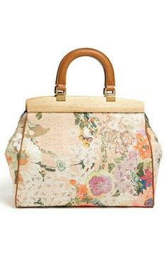We love this floral satchel by Tory Burch