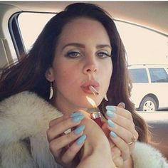 Lana Del Rey having someone else light her cigarette in the car long blue fake nails white fur coat dark brown natural beach waves hair Ultraviolence era Elizabeth Woolridge Grant, Elizabeth Grant, Queen Elizabeth, Foto Glamour, Born To Die, Brooklyn Baby, Lana Del Ray, Girl Crushes, Pretty People