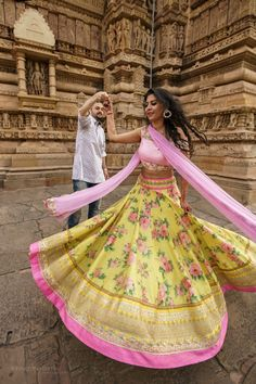 twirling bride, spinning bride, yellow and pink lehenga, floral print lehenga