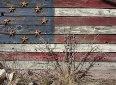 This beauty reminds me if the first flag we made from reclaimed wood!  Love it!