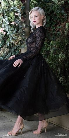 I definitely would wear a black wedding gown if it looked like this!