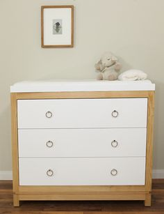 Simple Bedroom with Light Brown Wooden Dresser 3 White Drawers, Soft White Changing Table Dresser, and White Rectangular Drawers Double Knobs White Changing Table Dresser, Best Changing Table, Changing Table Topper, Over The Top, Home Furniture, Furniture Design, Nursery Furniture, Wood Nursery