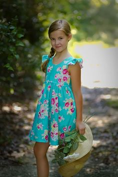 This beautiful handmade classic little girls dress is perfect for BACK-to-SCHOOL. It includes a full bodice with flutter sleeves that buttons in the back. The circle skirt is full of fabric, and will