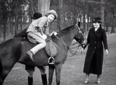 A young Queen Elizabeth mounts a horse in one segment of footage which will go on display together with more than 150 treasured toys, outfit...