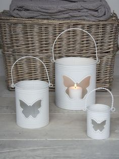 Lovely metal hurricane lanterns with a butterfly cut-out & a contemporary chalky white paint finish, inside & out.