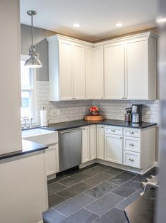 Slate Tile Floor, White Cabinets, Dark Countertop, White Marble Backsplash     Slate Floor For Kitchen?