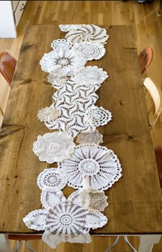 Doily Table runner. I was able to find a lot of doilies on ebay for cheap because I wasn't too worried about holes & stains. I just overlapped the next doily over a less than perfect area. The tables were covered with burlap & these runners on top. Beautiful!