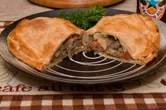 Cornish Pasties: Classic English pub grub. A light, flaky crust stuffed with a mixture of beef and vegetables.
