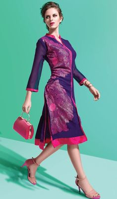 Cuddle your inner beauty and reveal unique ethnic style dressed in this tunic in purple color embroidered georgette. This pretty kurti is displaying some extraordinary embroidery done with lace and resham work. #straightkurti #violettunics #latestfashiontunic