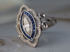 My first DK project! Diamonds, sapphires and bezels - oh my! - by - Antique marquise diamond and sapphire halo engagement ring Informations About My first DK project! Diamond Pendant Necklace, Ring Earrings, Diamond Jewelry, Diamond Rings, Deco Engagement Ring, Vintage Engagement Rings, Art Deco Diamond, Vintage Diamond, Bling Bling