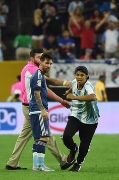 #COPA2016 A fan of Argentina's Lionel Messi runs after getting onto the field to greet him before the start of the second half of the Copa America Centenario...