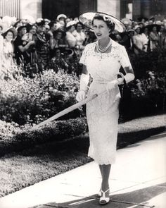 A white lace ensemble, with matching parasol, kept The Queen cool during her Australian tour in 1954. Untroubled by the obvious heat, Her Majesty kept her signature gloves well and truly on.