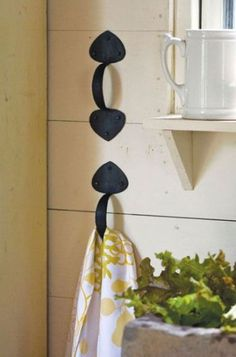 Use Drawer Handles  as Towel Holders.  Tack handles on the side of a cabinet or handy spot on the wall to pull your dish towel through.