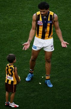 """AFL grand final Best pictures from Hawthorn celebrations - Cyril Rioli: """"My cousin passed away mid-year and I missed the Bombers game. Bomber Game, Pro Cycling, World Of Sports, Feel Good, Finals, Cool Pictures, Football, Running, Hawks"""