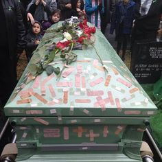 Personalizing a funeral: Instead of spreading flower petals, family & friends decorated this nurse's casket with band aids that they wrote a little message on. What a sweet way to honor all the healing she brought to others!