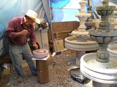 Artist carving a stone fountain, in Tonala, Mexico.