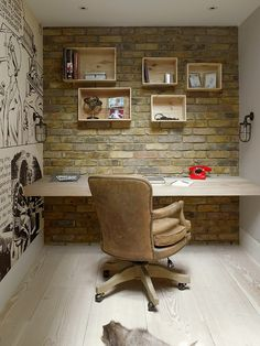 Home office with brick wall, custom wooden shelves and comic strip-styled wall art [Design: Stephen Fletcher Architects]