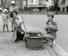 """April 21, 1927. """"Do ducks swim? Misses Eugenia Dunbar and Mary Moose."""" The main focus here is of course the horse trough, once a common item of street furniture in many big cities. National Photo glass negative."""