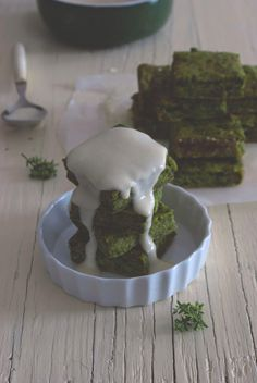 Savory spinach cake with taleggio cheese sauce