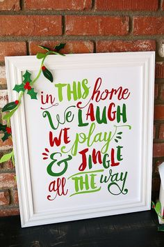 In This House We Laugh, We Play and Jingle all the Way! Adorable free print from eighteen25.com - comes in bright fun colors too!