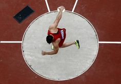 Cool discus shot.    United States' Lance Brooks competes in the men's discus qualification during athletics competitions at the 2012 Summer Olympics