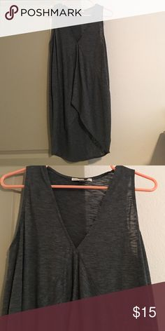 Express One Eleven Hi Lo Top I love this top! Sleeveless, dark gray color. V neck bottom has rubbed design. Front comes to waist, back scoops just below my butt. I won't wear with leggings since from is too short than I'd wear but very cute with skinny jeans. Express Tops Tank Tops
