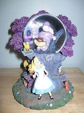 RARE Disney Snowglobe Alice in Wonderland w/ light up Cheshire Cat.  ONLY 1 Ebay