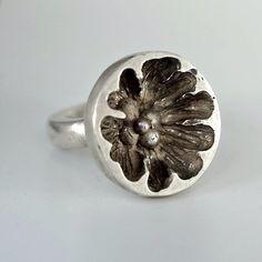 Sterling silver 'Poppy' ring made by wax carving