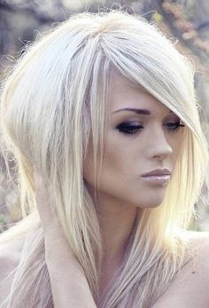 shaggy platinum blonde hairstyles with side bangs for straight hair