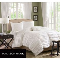 @Overstock - Eye-catching style meets comfort in the Madison Park Catalina cotton duvet cover set. The duvet features a cotton face and soft, brushed micro-fiber on the reverse, making it a chic and cozy addition to your contemporary decor.  http://www.overstock.com/Bedding-Bath/Madison-Park-Catalina-King-size-4-piece-Duvet-Cover-Set/6629543/product.html?CID=214117 $99.99