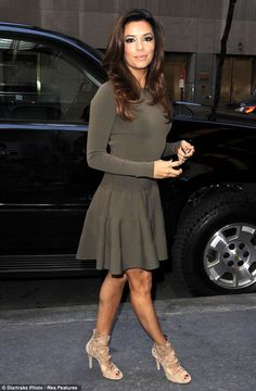 A pretty sight: Eva Longoria squeezed her figure into a becoming olive green dress for an appearance on The Dr Oz Show on Wednesday