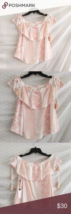 🍾$15 Astr embroidered off-the shoulder top Astr embroidered off the shoulder fllounce-y top.. Elastic off the shoulder with ties on either shoulder that have fringe at the end. White/cream colored top with salmon/pale pink colored embroidery. 100% rayon, feels like a cotton gauze. Size M but will also fit an XS-S because of the elastic. Amazing quality, excellent condition - NWT!!! Astr Tops